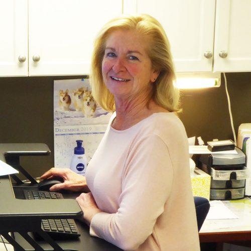 Deborah White sitting at her computer